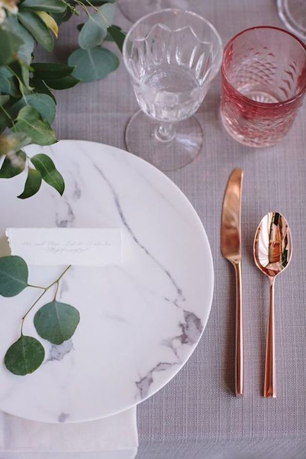 marble-plates-copper-tableware-and-greenery