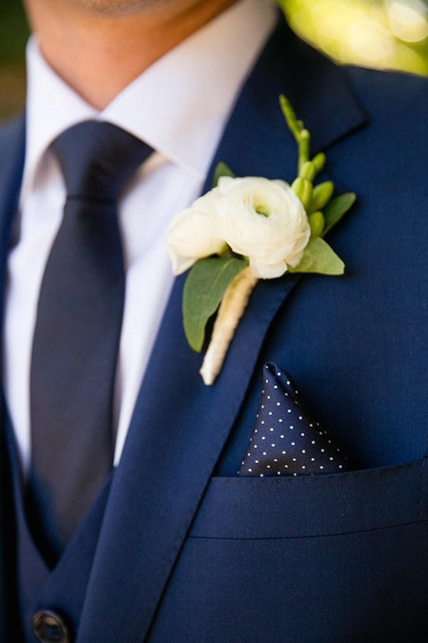 navy-blue-groom-attire-and-white-boutonniere